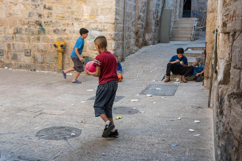 Children playing on the streets of Jerusalem royalty free stock image