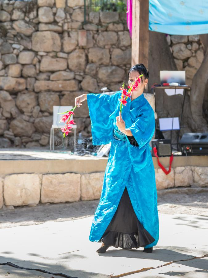 Dancer in national Japanese attire dancing Japanese dance at the annual festival `Jerusalem Knights` stock image