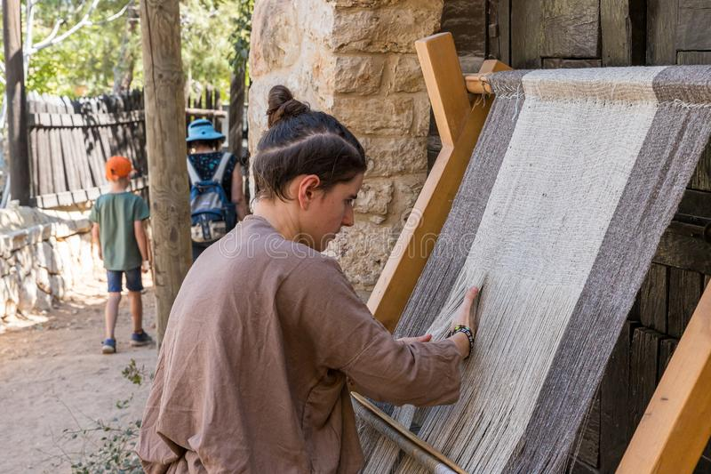Festival participant demonstrates work on a medieval loom at the annual festival Jerusalem Knights. Jerusalem, Israel, September 30, 2019 : Festival participant stock photos