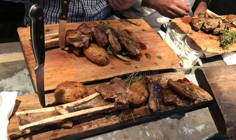 Mahane Yehuda Market Crave Gourmet Street Food. JERUSALEM - JUNE 13, 2018: Mahane Yehuda Market Crave Gourmet Street Food meal. Patrons sit down to enjoy a meal stock images