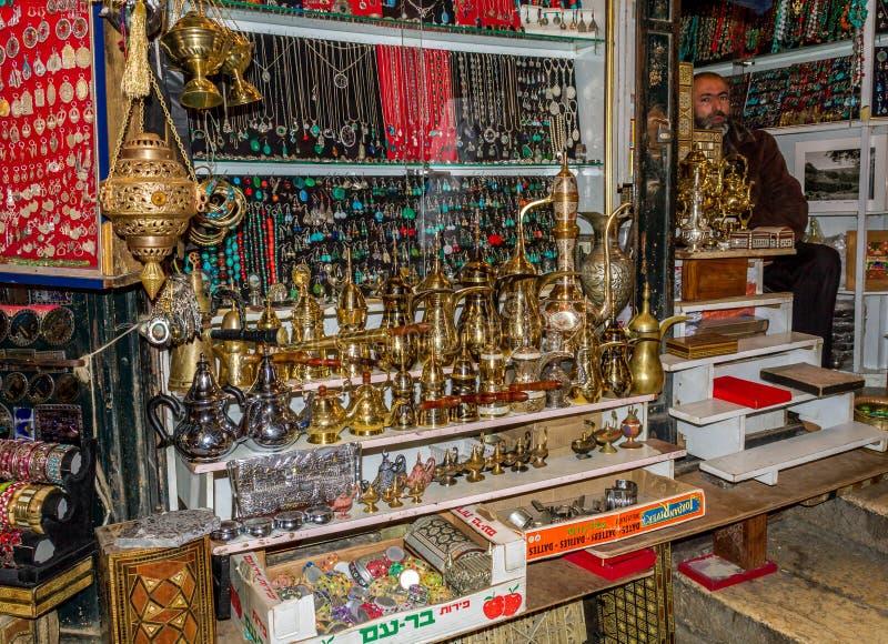 Jerusalem market in Old City, one of gift shops. JERUSALEM, ISRAEL - OCTOBER 12: One of gift shops with middle eastern souvenirs. Market in Old City in Jerusalem stock image