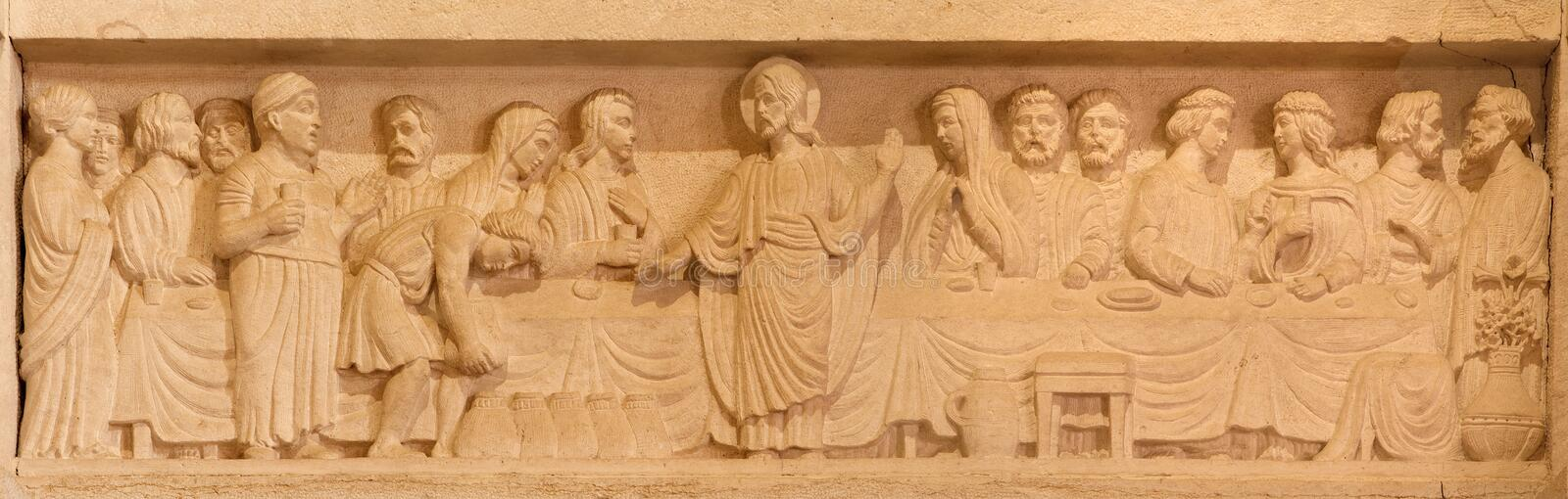 Jerusalem - The Marriage at Cana relief in Evangelical Lutheran Church of Ascension. JERUSALEM, ISRAEL - MARCH 3, 2015: The Marriage at Cana relief in royalty free stock photo
