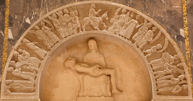 Jerusalem - The pieta and Entry of Jesus to Jerusalem (Palm sunday) relief in Evangelical Lutheran Church of Ascension. JERUSALEM, ISRAEL - MARCH 3, 2015: The stock photography