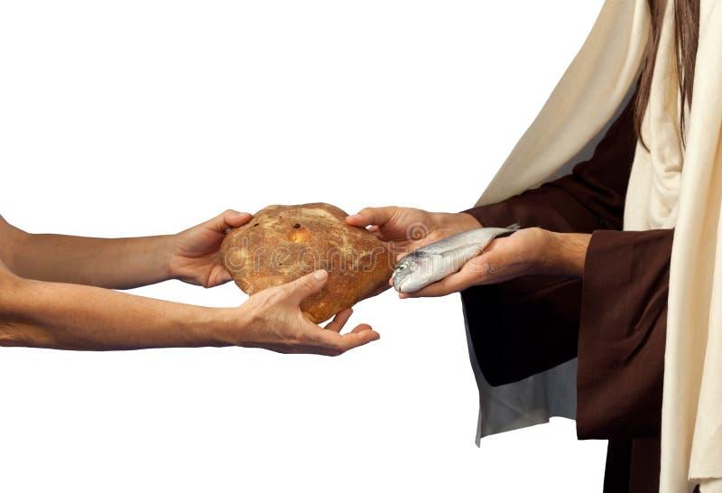 Jesús da el pan y pescados imagen de archivo libre de regalías