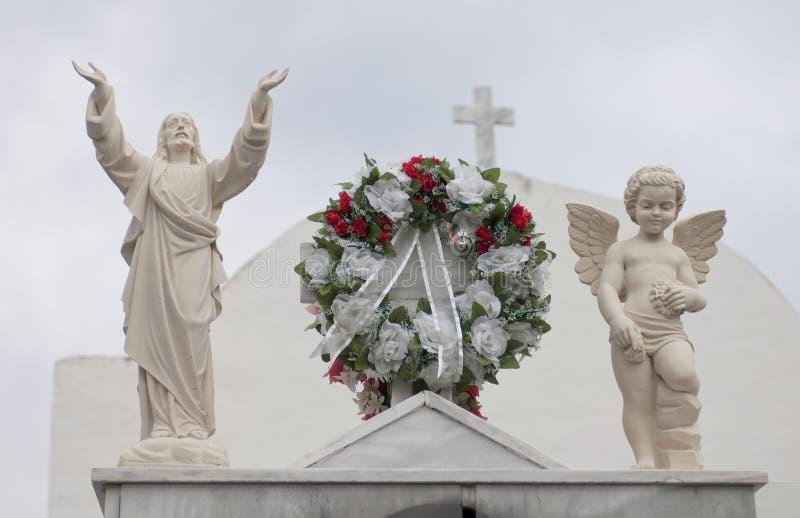 Jesús y figura del ángel imágenes de archivo libres de regalías