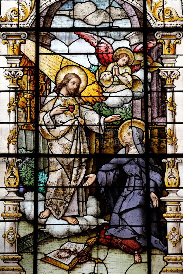 Jesús y santo Margaret Mary Alacoque imagen de archivo