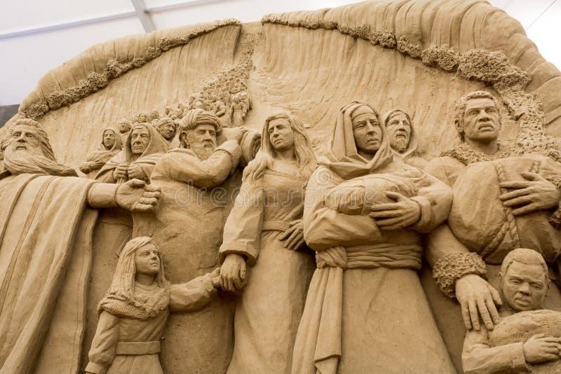 Jesolo lido, Italia: Piaska narodzenie jezusa 2016: cudowni piasków scultures przedstawia święty rodzinnego i exodus biblia obraz royalty free