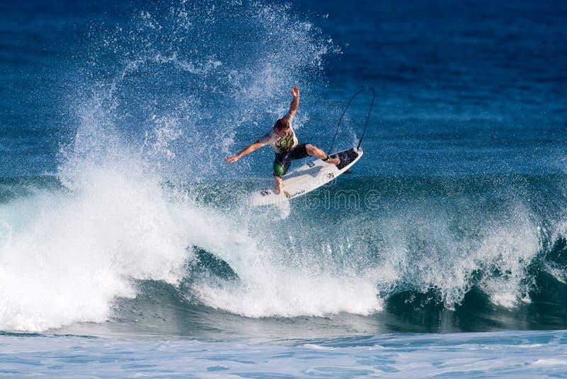 Jesse Merle Jones Surfing at Rocky Point in Hawaii. Professional surfer, Jesse Merle Jones, catches air on a wave while surfing at Rocky Point on the North Shore royalty free stock photo