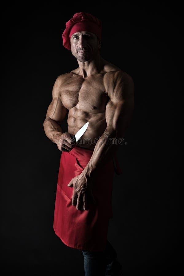 Jest podłym kucharzem Profesjonalisty mistrza kucharz na czarnym tle Obsługuje kucharza jest ubranym szefa kuchni kapelusz z mięś zdjęcia stock