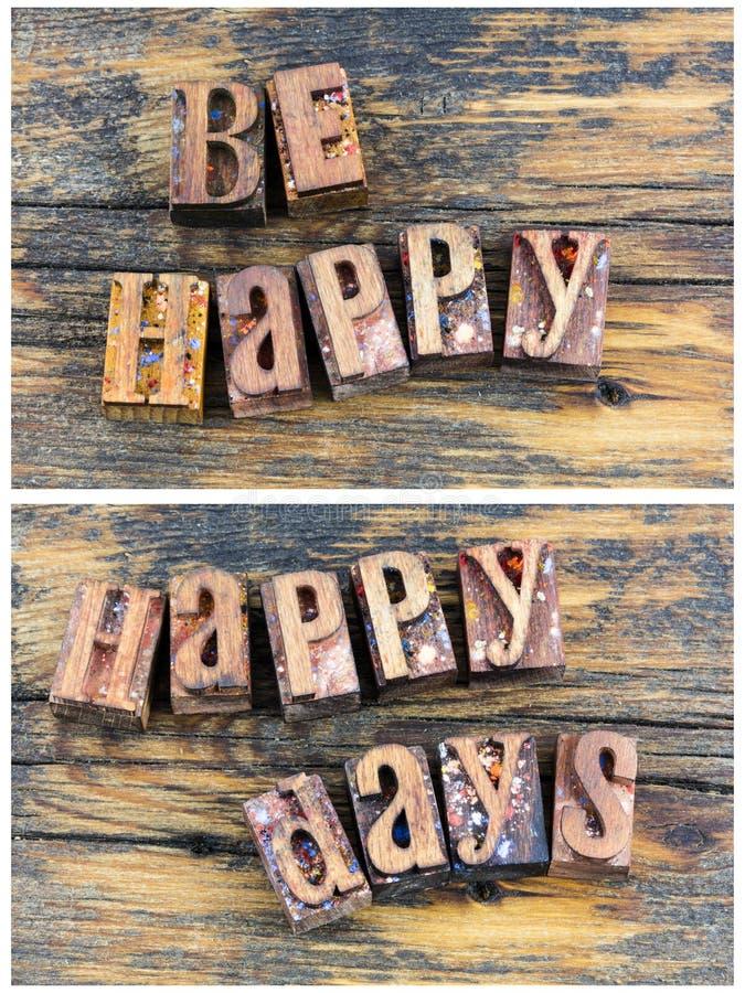 Jest szczęśliwym dnia powitania letterpress znakiem zdjęcia stock