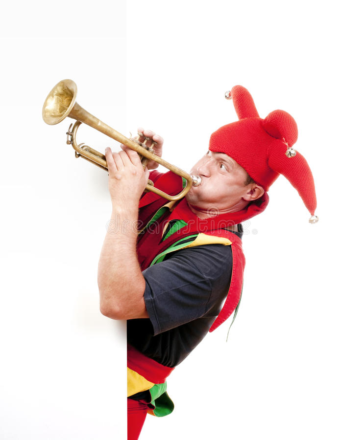 Jester Blowing Trumpet Stock Image