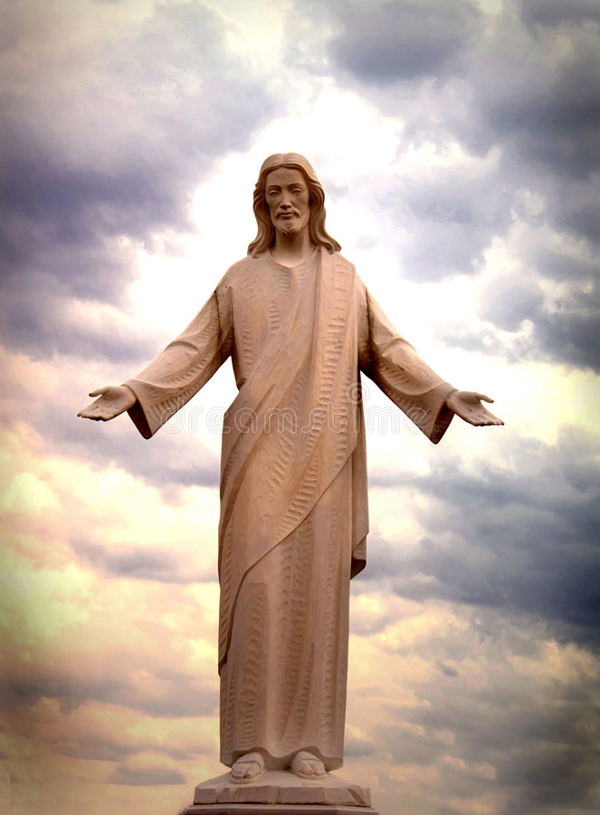 Jesus. Statue against beautiful sunset sky