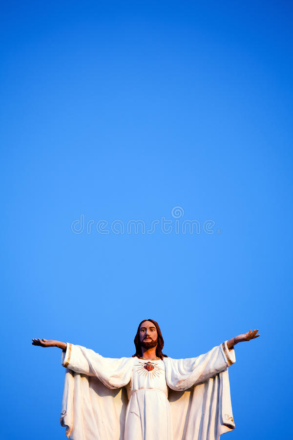 Jesus against blue sky royalty free stock photography