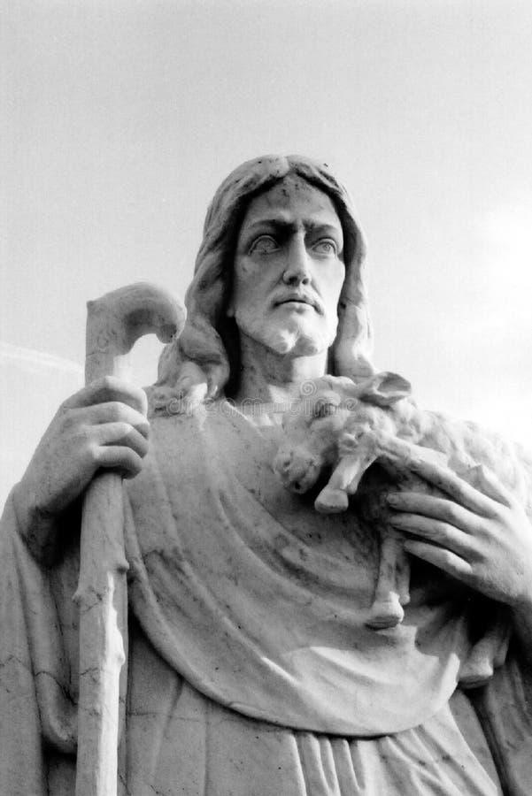 Jesus as shepherd statue stock photo