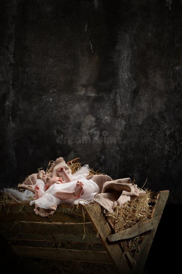 Jesus auf einer Krippe stockfoto