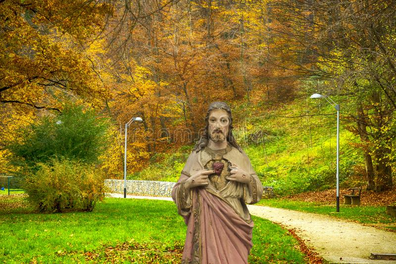 Jesus at the background of autumn nature stock images