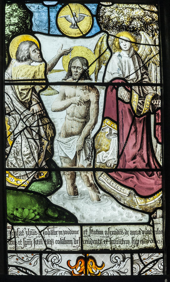 Jesus' Baptism. 16th Century Stained glass depiction of Jesus being baptised by John the baptist stock images