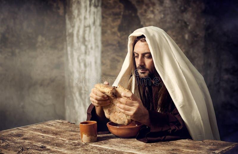 Jesus breaks the bread stock photo