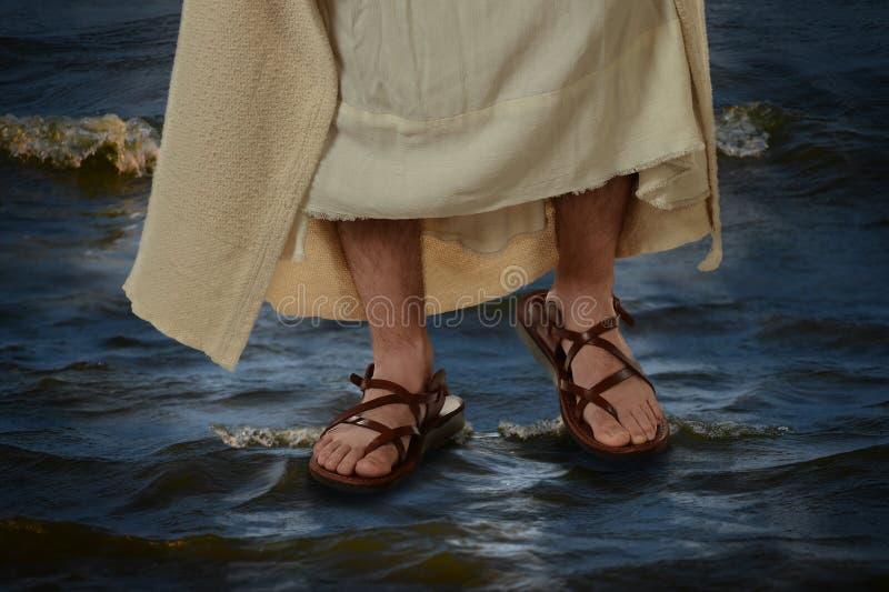Jesus che cammina sull'acqua fotografia stock