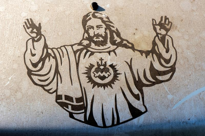 Jesus Christ on car hood. A drawing of Jesus Christ on a car hood in Goa, India royalty free stock image