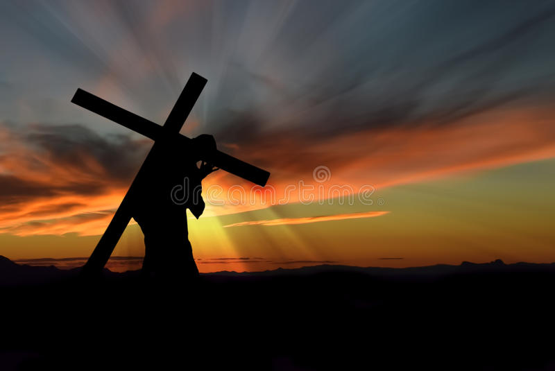 Jesus Christ Carrying Cross. Christ carrying cross up Calvary on Good Friday over dark and stormy sky