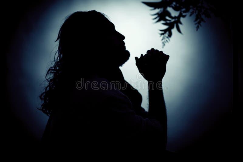 Jesus Christ che prega alla notte fotografia stock libera da diritti