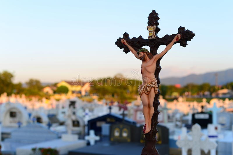 Jesus on Christ cross crucifixion at graveyard. Christian graveyard view with cross royalty free stock photos