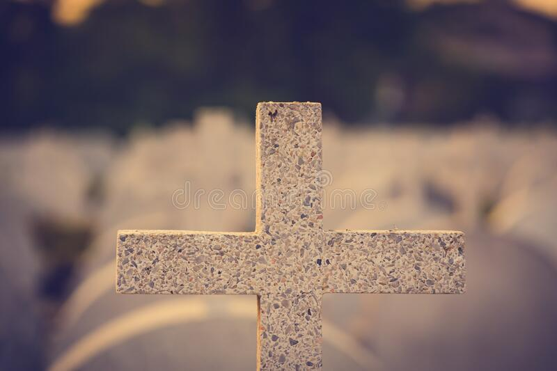 Jesus Christ cross. The Crucifixion, Resurrection and Easter concept. The Christian cross with a sunset scene in warm tone. Background with copy space stock photos
