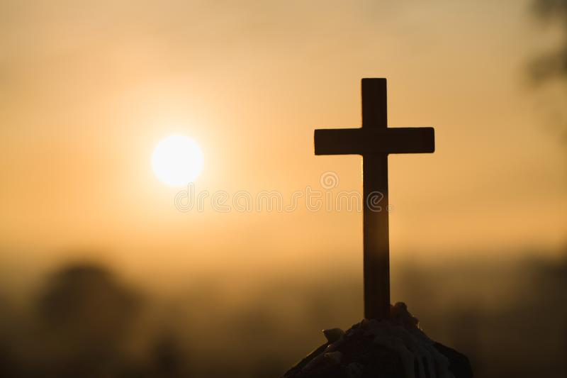 Jesus Christ cross. Easter, resurrection concept. Christian wooden cross on a background with dramatic lighting stock images
