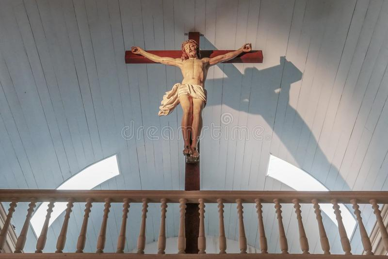 Jesus Christ on the cross with low angle view and magic light. Faith and religion royalty free stock photo