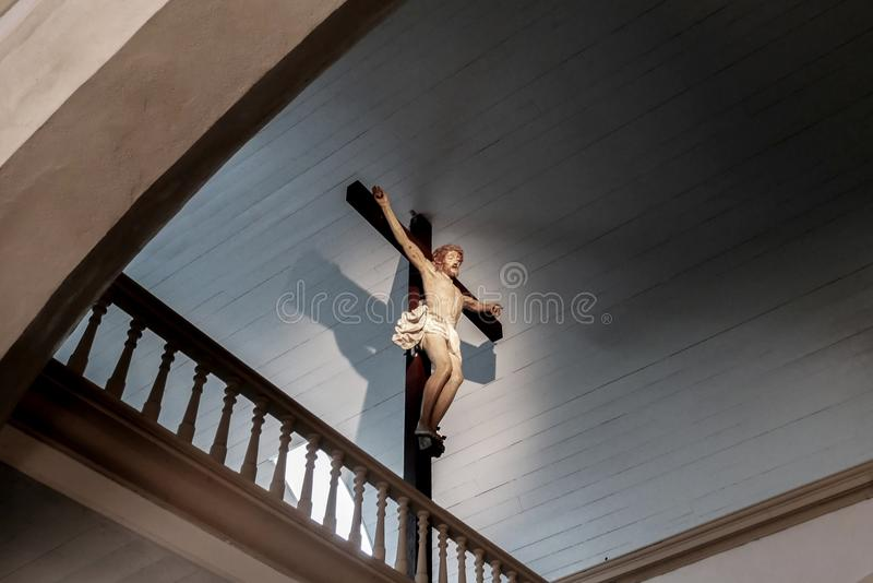 Jesus Christ on the cross with low angle view and magic light. Faith and religion royalty free stock images