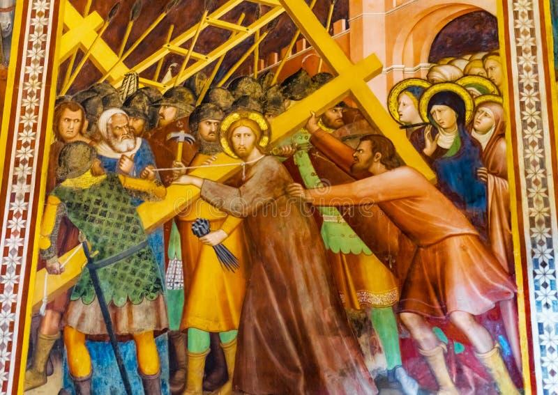 Jesus Christ Cross Medieval Fresco kyrka San Gimignano Tuscany arkivfoton