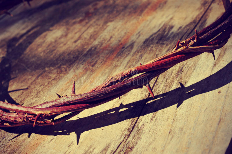 The Jesus Christ crown of thorns, with a retro filter effect. The Jesus Christ crown of thorns in the holy cross, with a retro filter effect stock photo