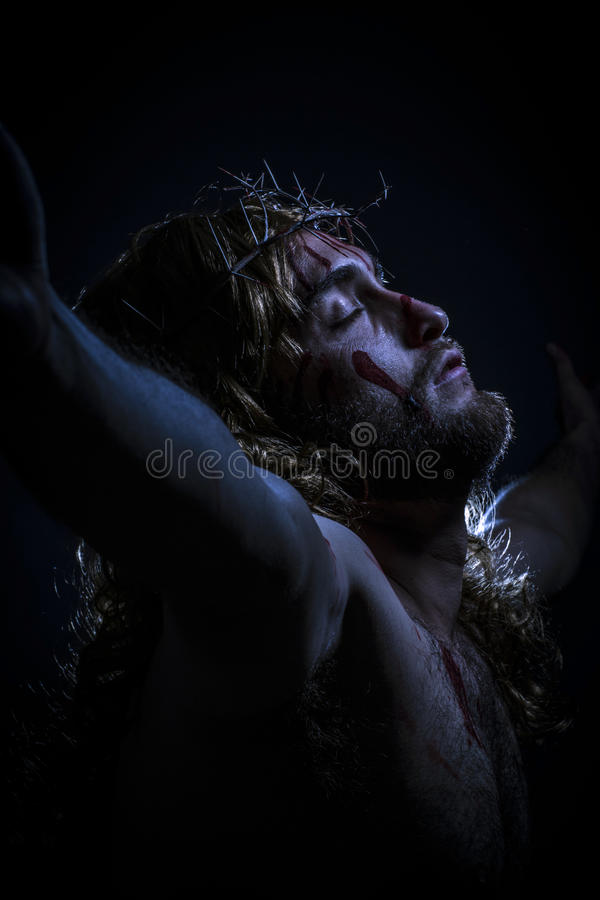 Jesus Christ crucified. With crown of thorns during the passion royalty free stock image