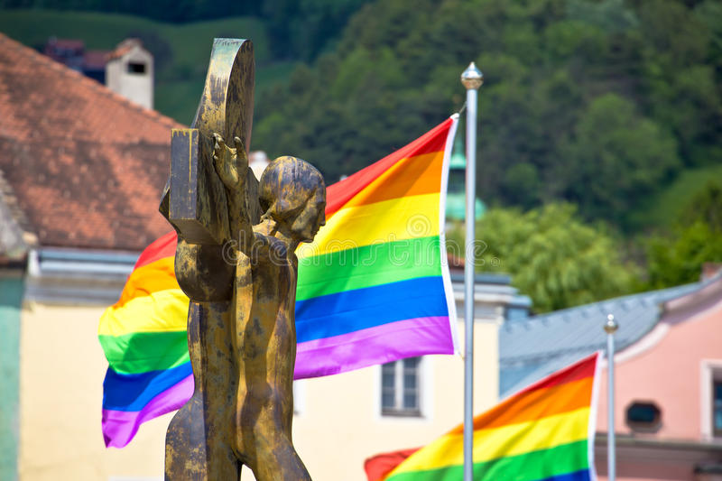 Jesus Christ crucifixion and gay pride flags view. Innsbruck, Tyrol, Austria royalty free stock photo
