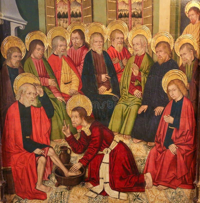 Jesus Christ, der die Füße der Apostel am letzten Abendessen wäscht stockbilder