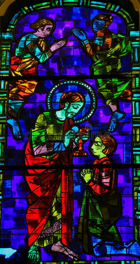 Jesus Christ giving communion - Stained Glass royalty free stock photos