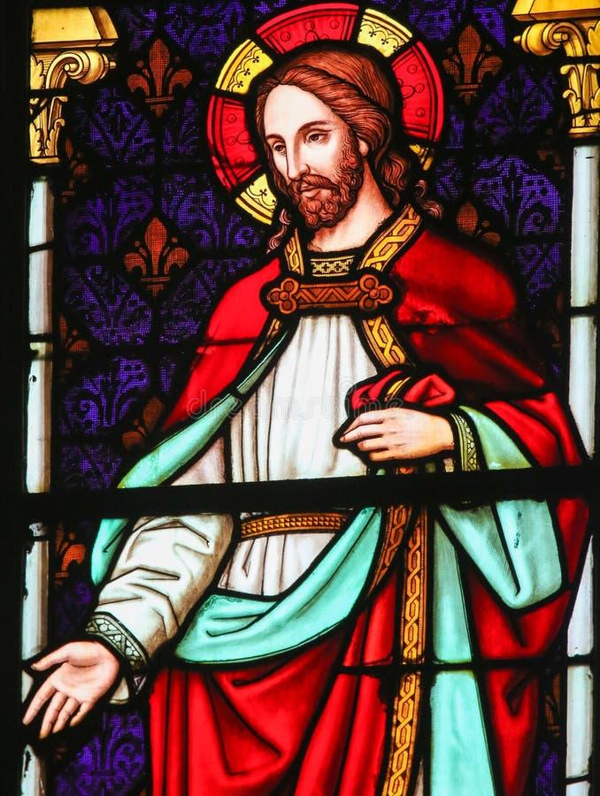 Jesus Christ - målat glass i den Mechelen domkyrkan arkivbilder