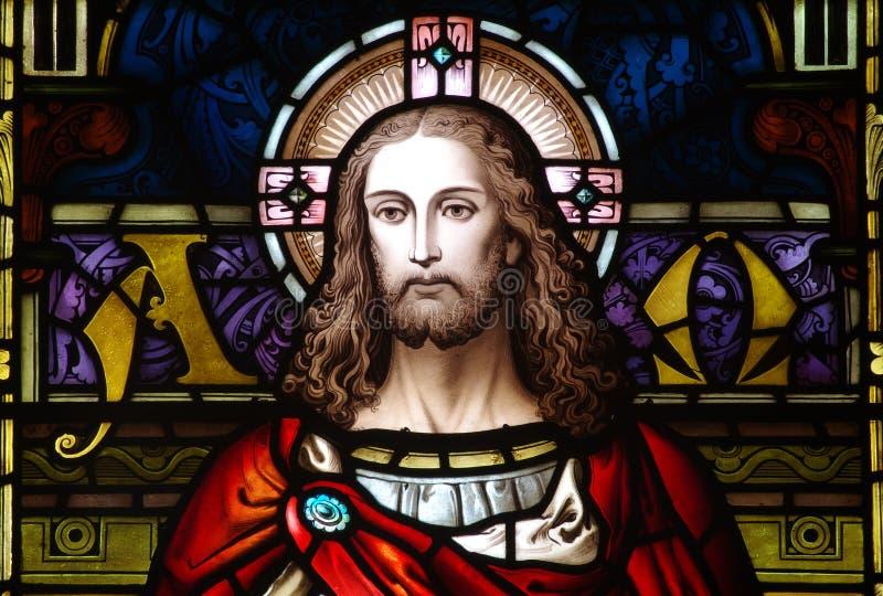 Jesus Christ no vitral (o começo e a extremidade) imagens de stock