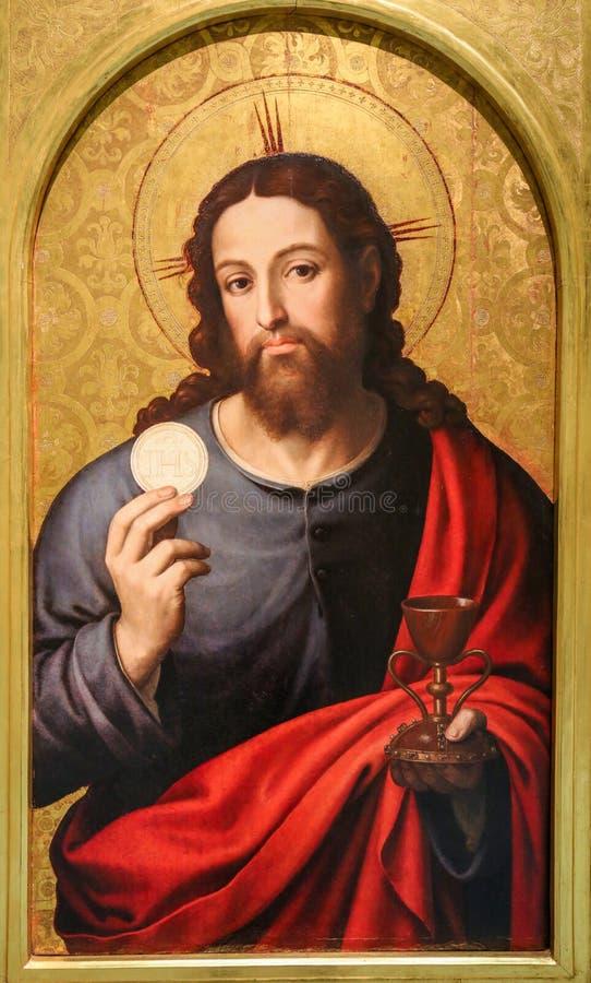 Jesus Christ som rymmer nattvarden royaltyfria bilder