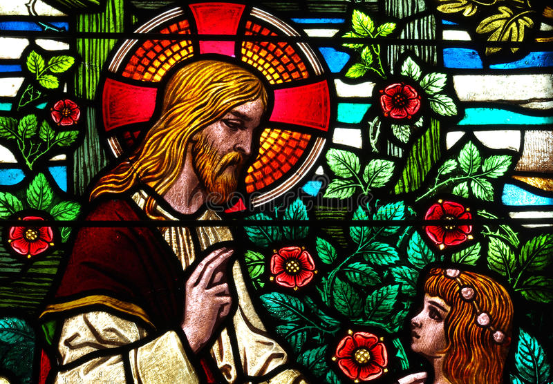 Jesus Christ speaking with a girl, in stained glass. Stained glass window depicting Jesus speaking with a girl royalty free stock photography