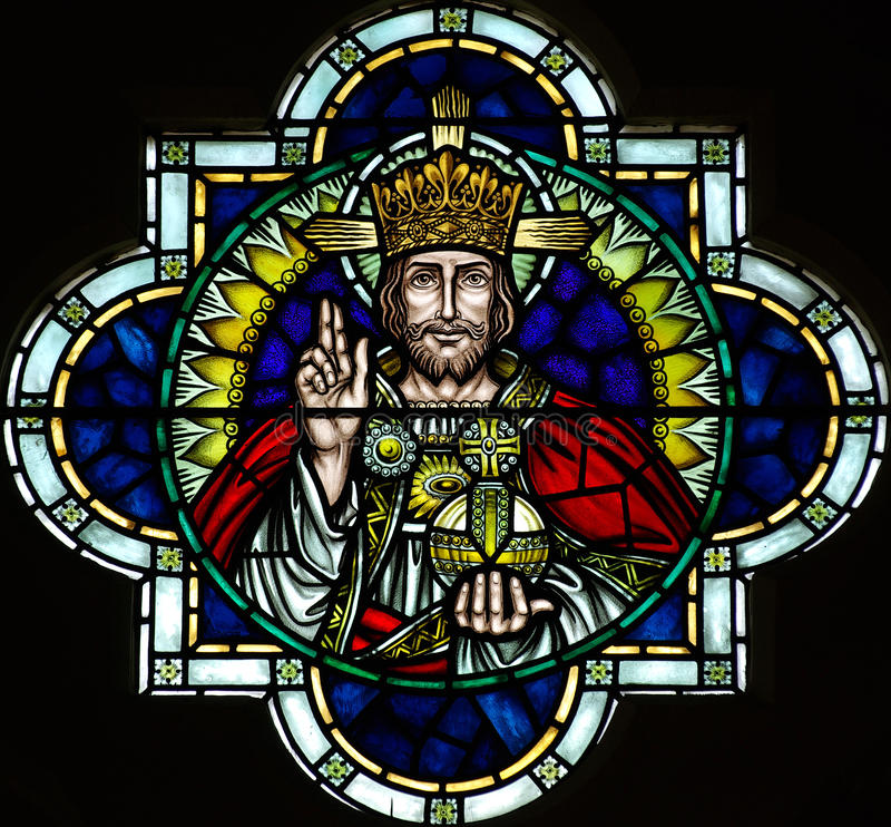 Jesus Christ in stained glass. Jesus Christ stained glass, lifting his hand stock photography