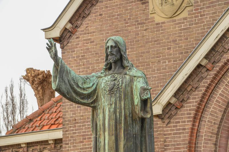 Jesus Christ Statue In Front Of A Church At Diemen The Netherlands royalty free stock image