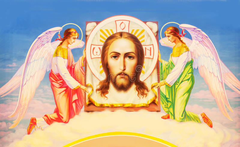 Jesus Christ between two angels royalty free stock photo