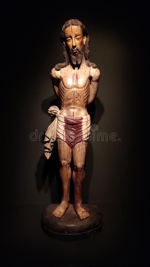 Jesus Christ wooden statue with blood dripping royalty free stock photo
