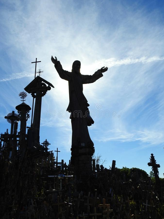 Jesus and cross in Cross hill near Siauliai town, Lithuania royalty free stock image