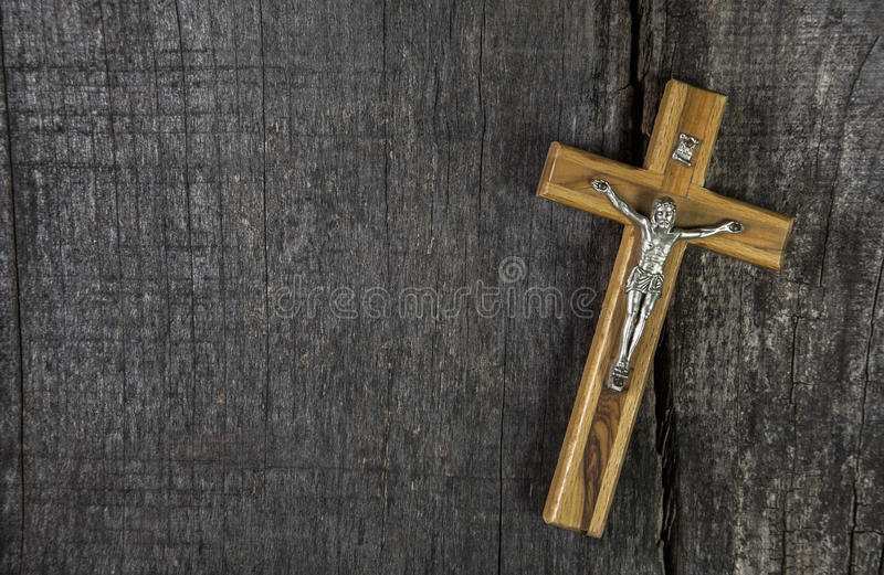 Jesus on cross: decoration on wooden background. Idea for a condolence card. royalty free stock images