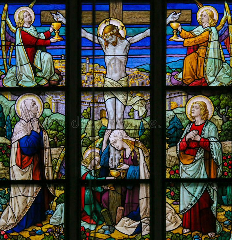 Jesus on the Cross - Stained Glass. Stained Glass window depicting Jesus on the Cross, in the Cathedral of Saint Rumbold in Mechelen, Belgium stock photography