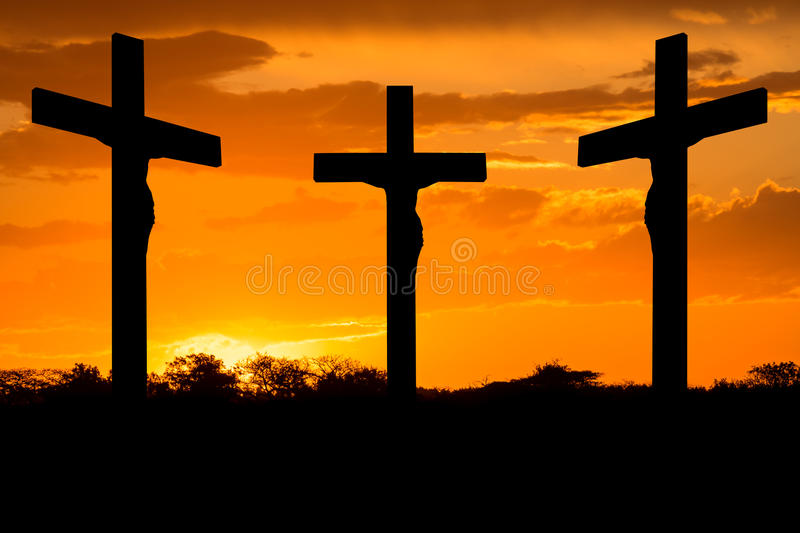 Jesus and crosses. Backlight Crosses of Jesus Christ with the two thieves at sunset royalty free stock photography