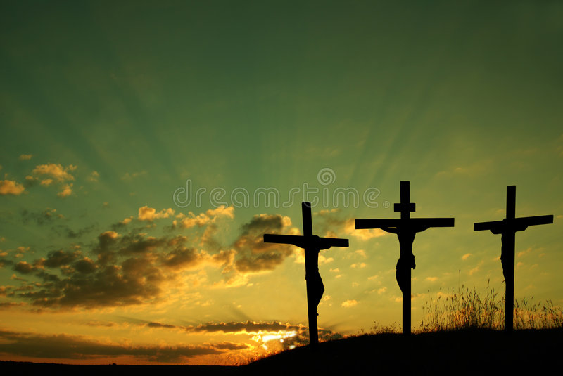 Jesus crucify. Silhouette of Jesus Christ and two thieves crucified stock photos